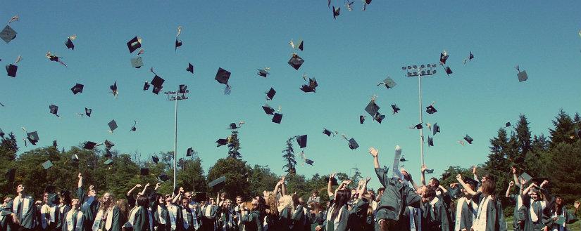 high school graduation throwing caps